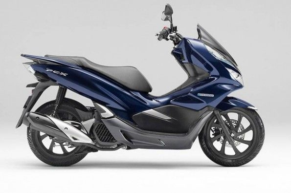 The world's first mass-production motorcycle hybrid system will first be seen on the Honda PCX 125 scooter.