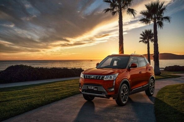 Red Color Mahindra XUV300 on Road at Sunset