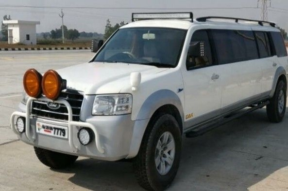 Modified White Color Ford Endeavour SUV Front Profile