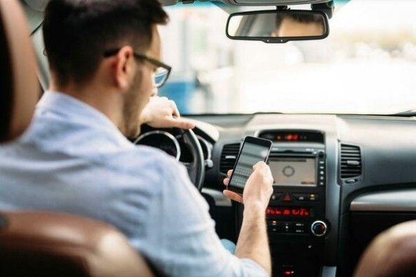 Driver Using Cell-Phone While Driving a Car