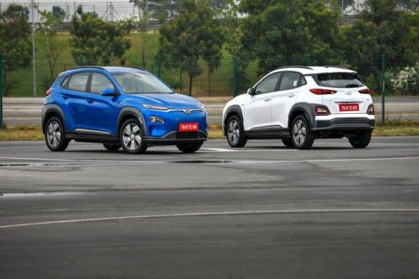 Blue and White Color Hyundai Kona Electric Parked Together