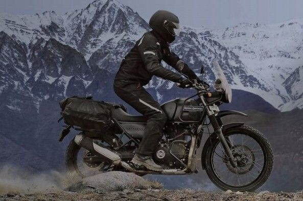 Black Color Royal Enfield Himalayan Side Profile With Rider