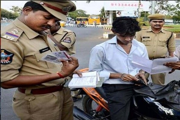 Traffic Police Imposing Fine on Rider Without Helmet