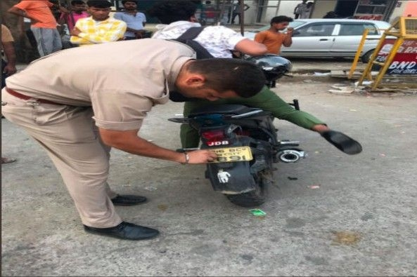 Traffic Police Seizing Motorcycle With Illegal Number Plate