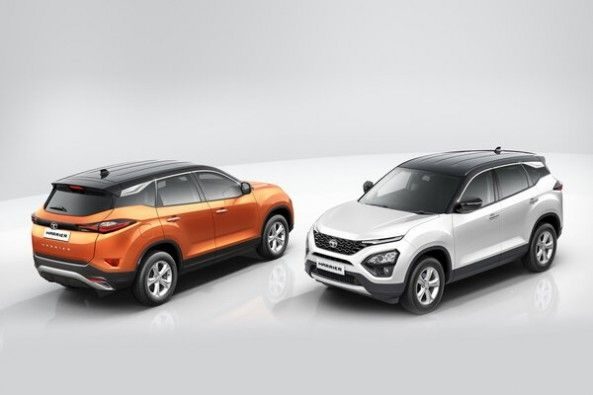 Copper and Silver Color Tata Harrier Standing Against Each Other