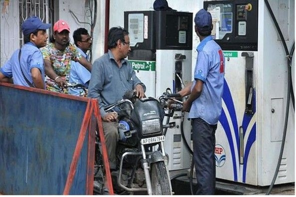 Petrol Pump Attendant Filling Fuel in Motorcycles