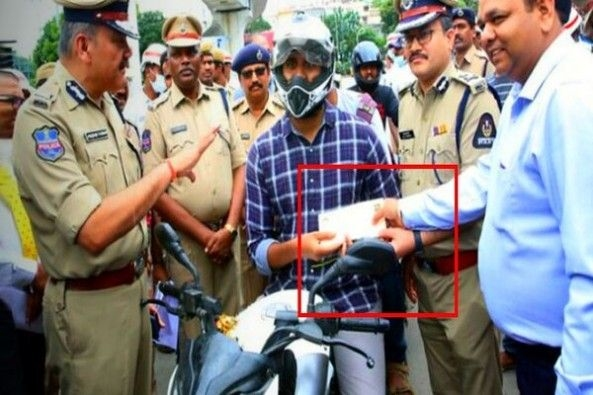Traffic Police Awarding Movie Ticket to Motorist