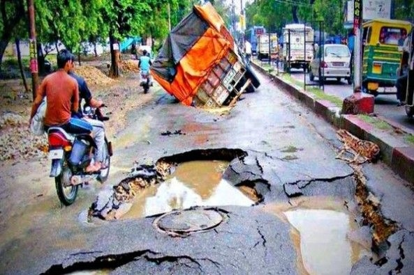 Truck Accident on Road With Potholes