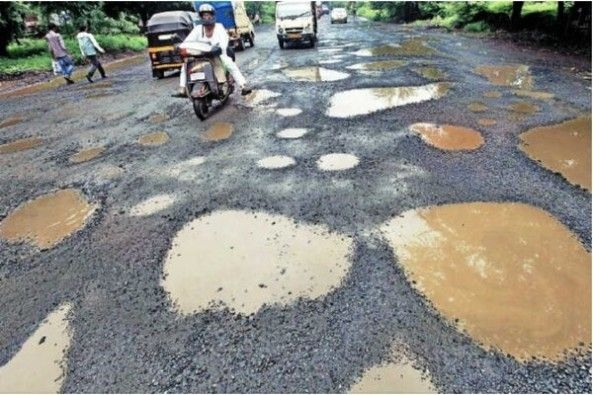 Potholes Filled Roads in India With Vehicles Struck