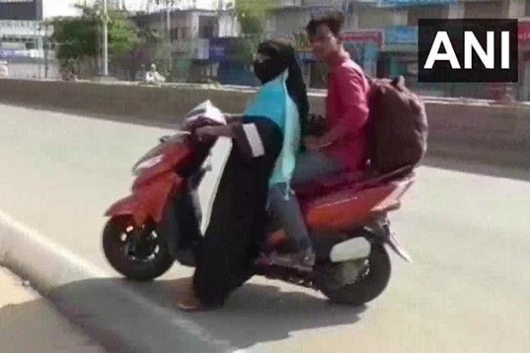 Woman Rides Her Honda Scooty