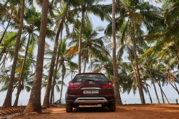 Red Color Honda WR-V Rear Profile Among Trees
