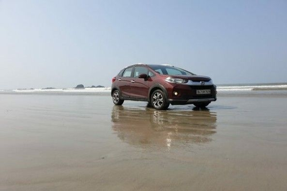 Red Color Honda WR-V Side Profile by Beach Side
