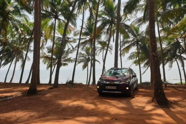 Red Color Honda WR-V Front Profile Among Trees